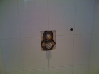 These pictures show the archway and shower valve prior to new walls being built