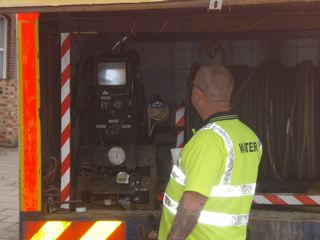 One of our senior engineers is monitoring the engineers that are inside the premises, and using 3 way radio to communicate the direction they need to go, to cut out the scale in the drain system with the 10000psi high pressure unit.  By using this technology, we are able to carry out a complete de-scale in a safe and correct manner