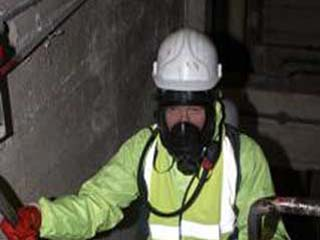 Engineer preparing to go into confined space area after tankers had removed approx 20,000 litres