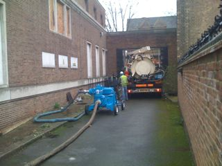 Tanker and engineers preparing to remove contaminated waste