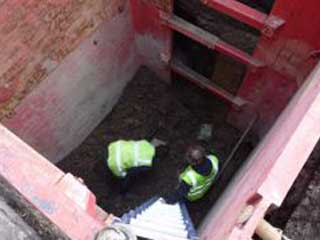 Picture shows safety hydraulic box put in place, to allow the engineers to expose drain by hand, cut out damaged pipe work and replace with new