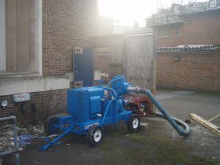Installation of pump into basement area