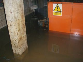Shows storm water still in the lower basement area that has now completely ruined the boiler room showing the level after removing approx 15 tons of water