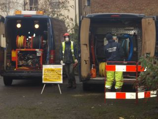 Emergency team preparing high pressure jet machines clean down contaminated walls and floors
